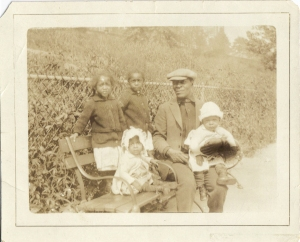 My Grandfather William Palmer with some of his children. My Dad is not in this photo since he was born in 1930 and the photo taken in 1926.
