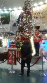 Stephen in front of Penn Station Holiday decorations